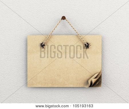 Cardboard Sign With Ragged Holes On The Wall
