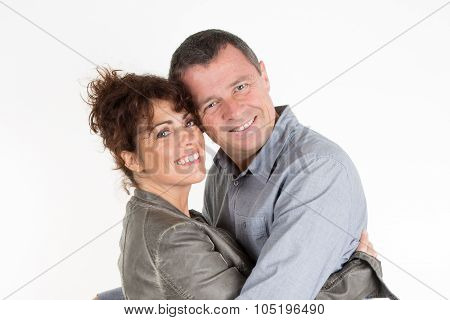 Middle Aged Beautiful Couple In A Sweet Cheek Cuddle