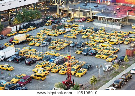 USA, NEW-YORK - AUG 25, 2014: Car parking near railway and Home2 Suites by Hilton at summer sunny day.