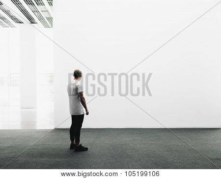 White gallery interior with empty and white canvas.