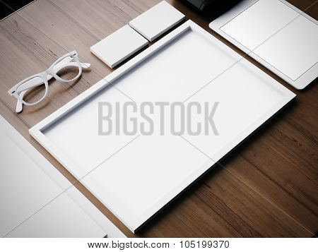 White business blank elements on a wooden table. 3d render