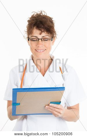 Female Doctor Writing A Medical History In A Folder Isolated