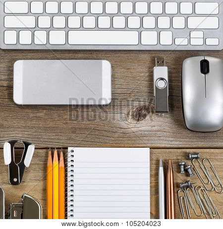 Workspace With Simple Office Supplies On Aged Desktop
