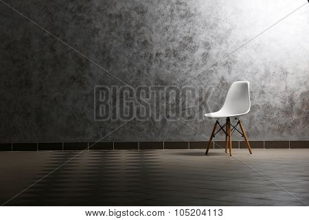 Chair on grey wall background