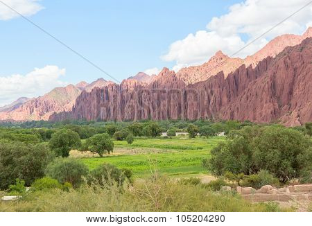 Colored mountains and green valley