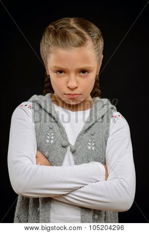 Little girl standing on black background