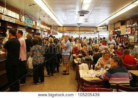 Historical Katz's Delicatessen full of tourists and locals.