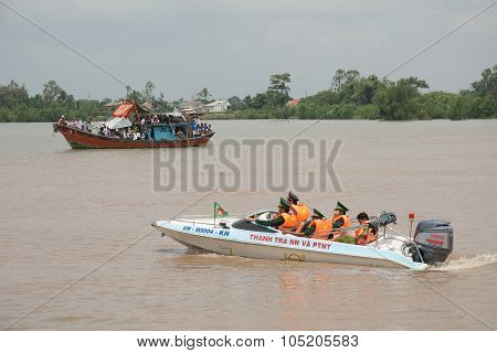 Police Patrol The Harbour In Mekong Delta, Vietnam