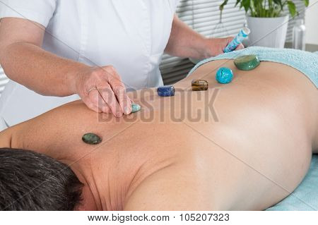 Man Having Stone Massage In A Spa Salon