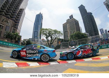 KUALA LUMPUR, MALAYSIA - AUGUST 09, 2015: Scott McLaughlin leads Chaz Mostert as they race in the streets of Kuala Lumpur in the V8 Supercars Street Challenge at the 2015 Kuala Lumpur City Grand Prix.