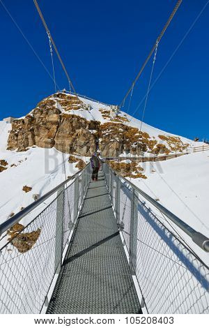 Suspension bridge at mountains ski resort Bad Gastein Austria