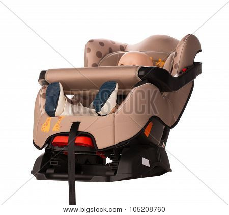Baby doll in a booster seat for a car