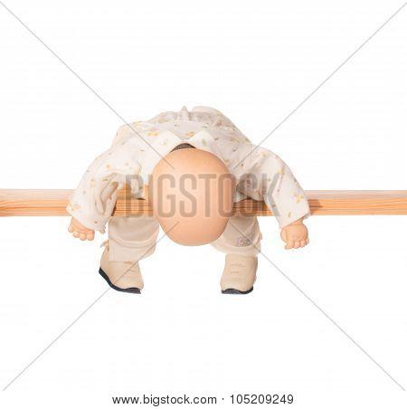 Baby doll on a crossbar