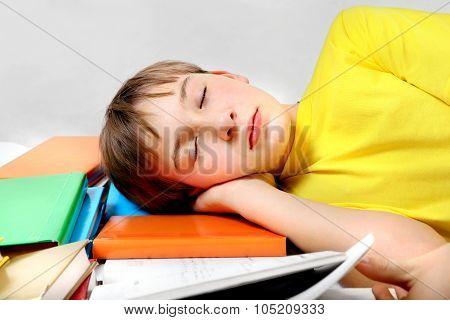 Tired Kid Sleep On The Books