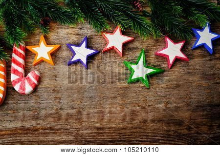 Wooden Background With Wooden Toys And The Branches Of The Christmas Tree For Christmas