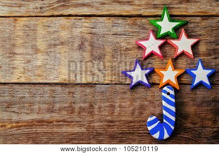 Wooden Background With Wooden Toys In The Shapes Of Stars And Christmas Shaped Sticks