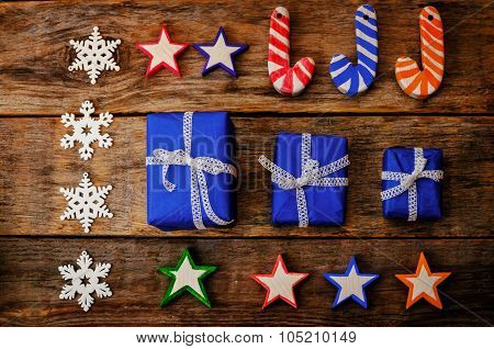 Wooden Background With Wooden Toys, Gifts And The Snowflakes