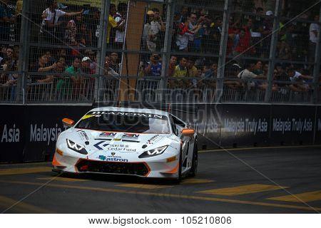 KUALA LUMPUR, MALAYSIA - AUGUST 09, 2015: Eduardo Liberati in a Lamborghini Super Trofeo LP620 car races in the Lamborghini Blancpain Super Trofeo Race at the 2015 Kuala Lumpur City Grand Prix.
