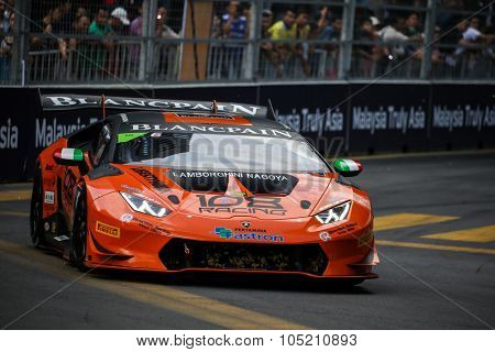 KUALA LUMPUR, MALAYSIA - AUGUST 09, 2015: Yusuke Hayashi in a Lamborghini Super Trofeo LP620 car races in the Lamborghini Blancpain Super Trofeo Race at the 2015 Kuala Lumpur City Grand Prix.