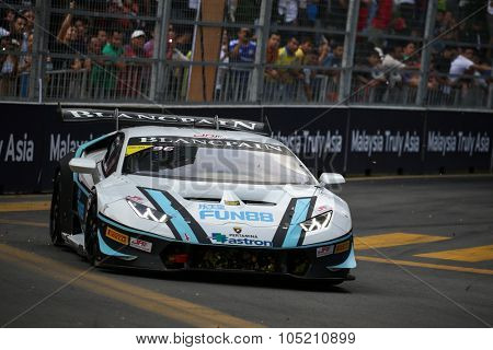 KUALA LUMPUR, MALAYSIA - AUGUST 09, 2015: Zhang Da Sheng in a Lamborghini Super Trofeo LP620 car races in the Lamborghini Blancpain Super Trofeo Race at the 2015 Kuala Lumpur City Grand Prix.