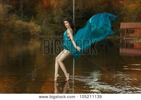 Girl Dances A Pole Dance In The Forest On Lake.
