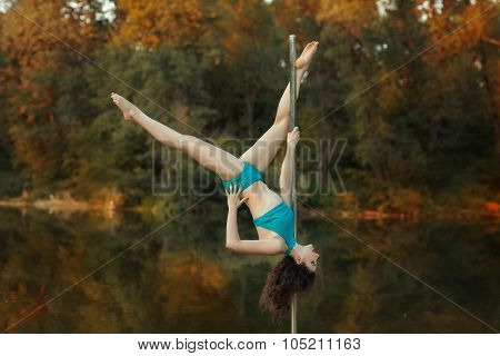 Girl Does Tricks On A Pole Dance.