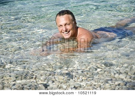 A happy smiling man in the sea
