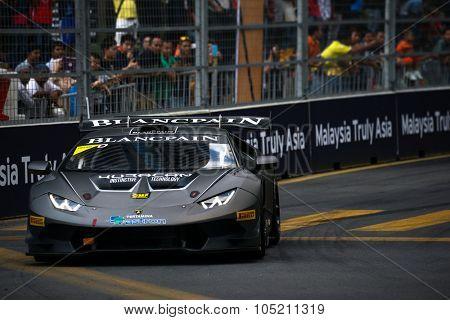 KUALA LUMPUR, MALAYSIA - AUGUST 09, 2015: Cedric Sbirrazzuoli in a Lamborghini Super Trofeo LP620 car races in the Lamborghini Blancpain Super Trofeo Race at the 2015 Kuala Lumpur City Grand Prix.