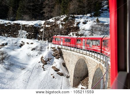 Bernina Red Train Climbing In The Snow, View From Window