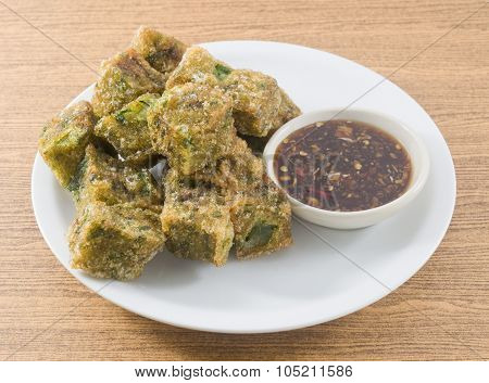 Fried Steamed Garlic Chives Dumpling Served With Spicy Soy Sauce