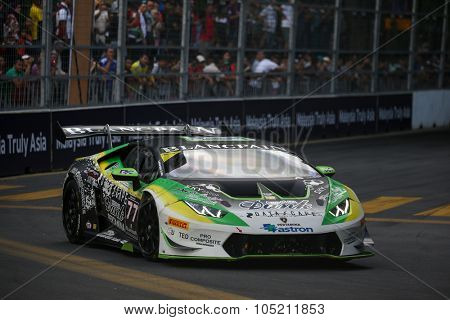KUALA LUMPUR, MALAYSIA - AUGUST 09, 2015: Masaru Suzuki in a Lamborghini Super Trofeo LP620 car races in the Lamborghini Blancpain Super Trofeo Race at the 2015 Kuala Lumpur City Grand Prix.
