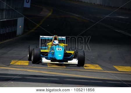 KUALA LUMPUR, MALAYSIA - AUGUST 09, 2015: Hong Shikie in a single seater racing car race in the city street circuit in the Formula Masters China Series Race at the 2015 Kuala Lumpur City Grand Prix.