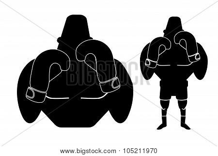 Silhouette of big muscular boxer in fight stance