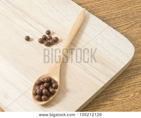 Herbal Cough Pastille On A Brown Wooden Spoon