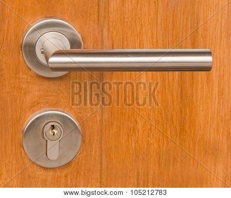 Lock And Door Handle On Wooden Door