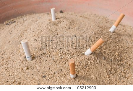 Cigarettes Butts In An Ashtray Big Bin