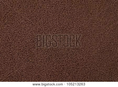 Texture Background Of The Dark Brown Plastic Doormat