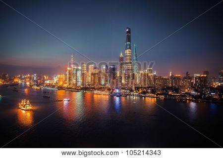 Panorama view of Shanghai city scape at night time. Aerial