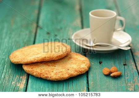 Empty Cup For Espresso, Silver Spoon, Two Homemade Almond Cookies And Whole Almonds