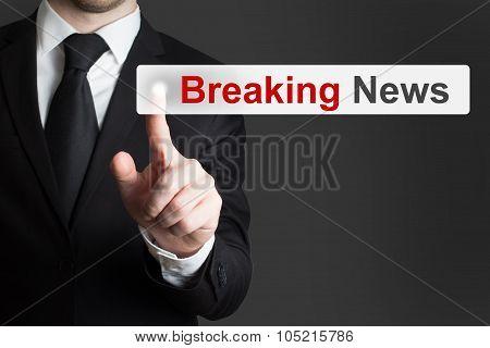 businessman in black suit pushing flat button breaking news