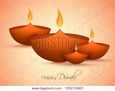 Glossy illuminated oil lit lamps on floral decorated background for Indian Festival of Lights, Happy Diwali celebration.