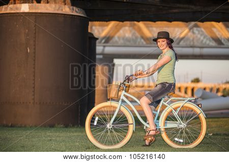 Young Lady Riding A Bike At Sunset