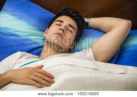 Handsome young man sleeping