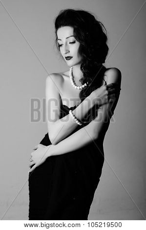 Black And White Contrast Portrait Of Beautiful Woman With Perls In Black Dress