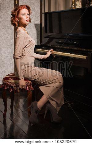 Beauty Woman In Evening Dress Playing Piano