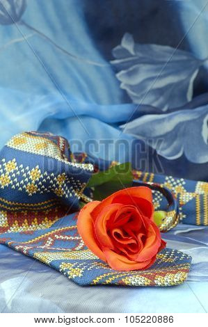 Colored Necktie With Red Roses On A Blue Background