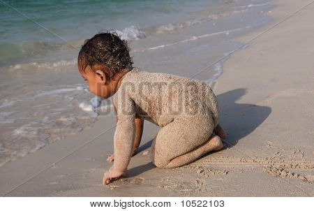 Infant Baby Palying In Beach