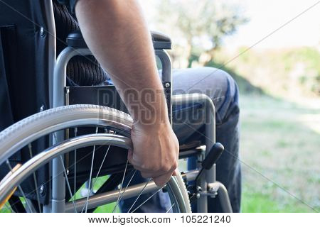 Paralyzed man using his wheelchair