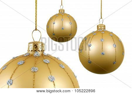 Several Gold Christmas Balls Or Baubles With Glass Decoration Hanging Isolated On White Background