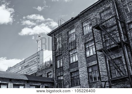 Brick Building With Windows On Sky Background